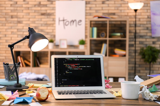 Home workplace with laptop on table