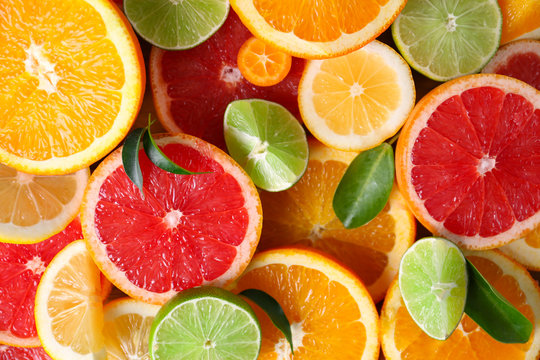 Slices of fresh citrus fruits as background