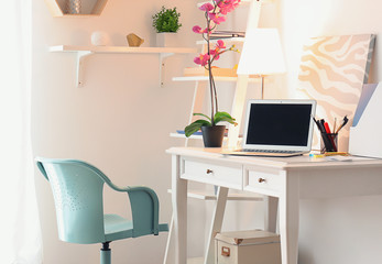 Interior of room with stylish workplace at home