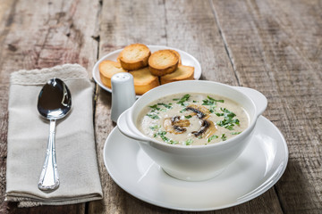 Cheese cream soup with mushrooms.