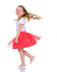 A cheerful little girl is dancing.