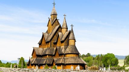 The 13th century Heddal stave church on a sunny day. This is the biggest stave church in Norway.