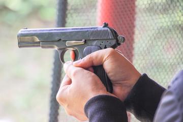 Gun on hand, gun concept or gun use.