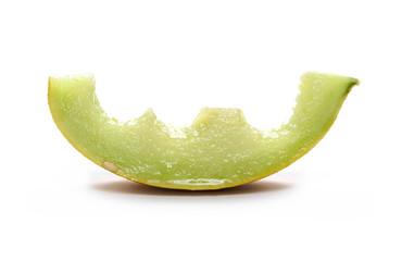 Fresh bitten cantaloupe melon slice isolated on white background