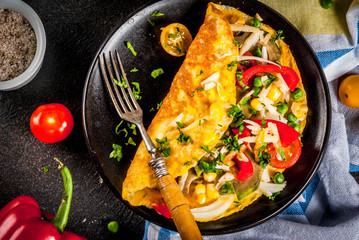 Healthy breakfast food, Stuffed egg omelette with vegetable, dark concrete background copy space top view
