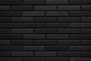 Black stone brick wall pattern and seamless background