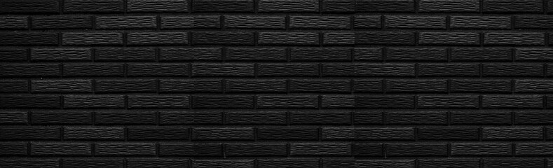 Panorama of black stone brick wall background