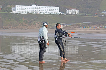 kitesurfers on Saunton Sands beach