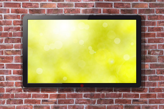 Smart TV With Bright Green Spring Wallpaper - Brick Wall In Background