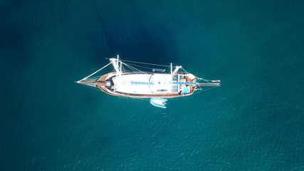 Aerial drone birds eye view of sail boat docked in the Aegean sea, Greece