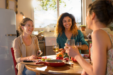 Multi-ethnic group of friends having fun while preparing lunch