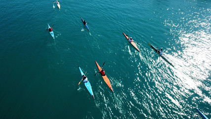Aerial drone bird's eye view of sport canoe in turquoise clear waters