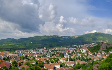 Panorama of a city in the mountains on a background of a cloudy sky 2