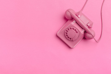 vintage phone on color background