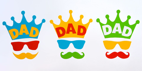Happy Father's Day.Postcard for dad.Crown, glasses and mustache on white background.