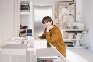 Portrait of woman working in studio