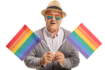 Mature man with rainbow flags