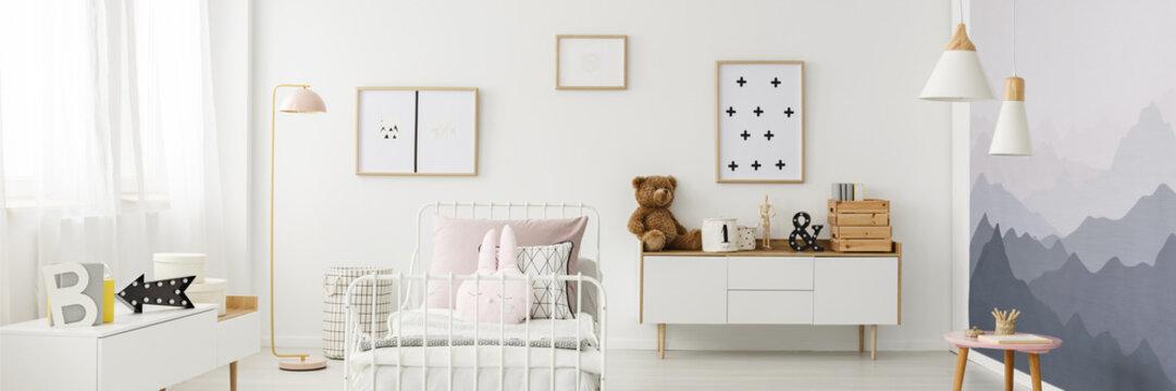 Posters in girl's bedroom interior