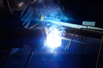 Welding of steel reinforcement. Sparks and light from welding. Electric welding