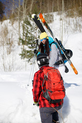 Picture of man from back and women with mountain skis