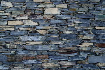 The blue grey yellow stone wall