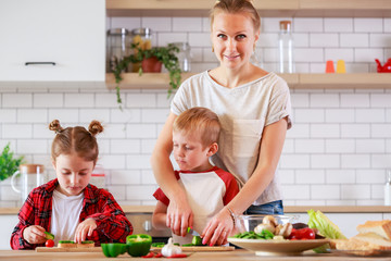 Image of mother with daughter and son cooking at table