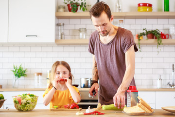 Picture of man with his daughter cooking dinner