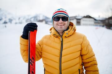 Photo of sporty man with mountain skis