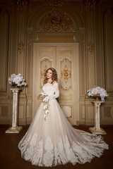 Beautiful bride in luxury baroque interior. Full-length portrait.