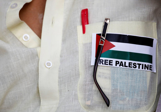 A demonstrator wears a sticker on his shirt during a protest demanding for the liberation of Jerusalem's Al-Aqsa mosque, one of the holiest shrines in Islam, in New Delhi