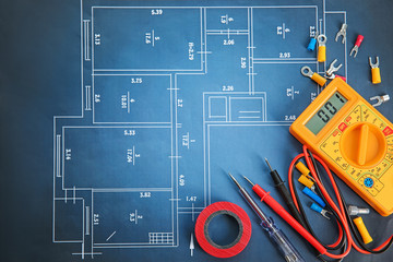 Flat lay composition with electrical tools on house plan