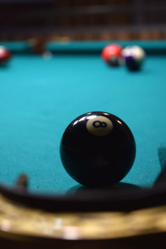 colored balls of the American pool and cue on the billiard table