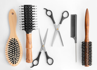 Professional hairdresser's set on white background, top view