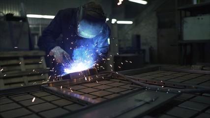 Welder at work. The welder works in the workplace.