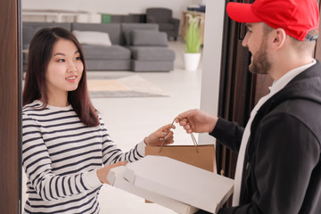 Young man delivering food to client at doorway