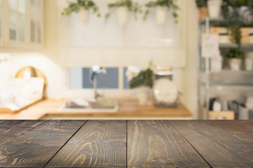 Blurred background. Modern defocused pastel kitchen or cafe with tabletop and space for you.