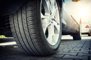 Car tire close up, parked car low angle shot Wall mural