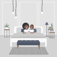Modern bedroom interior. Couple of young african american adults lying in the double bed. Scandinavian design.