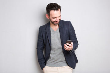 fashionable man looking at cellphone