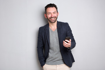happy man with beard holding mobile phone
