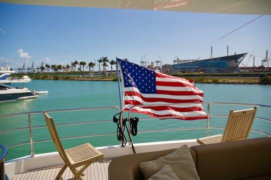 Waving American Flag on Yacht in Miami, Florida.