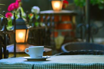 Evening cup of coffee in Italian restaurant