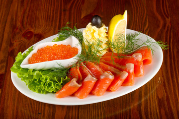 Sliced trout and red caviar