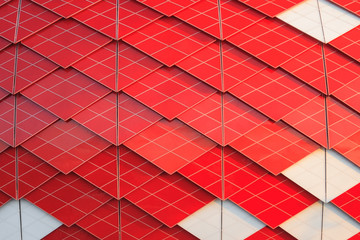 Red and white facade of modern building with geometric pattern as background, texture, abstract