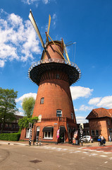 Aluminium Prints Mills Utrecht, Netherlands- 02 MAY, 2018: Windmill is one of the most famous symbols of the Netherlands. Traditional old mill and houses