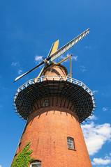 Foto op Canvas Molens Windmill is one of the most famous symbols of the Netherlands. Traditional old mill against the blue sky. Utrecht, Netherlands. Close-up photo in sunny spring day