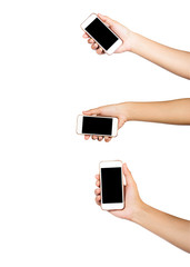 Female hand holding multiple touch screen tablet or smartphone black screen isolated on white background. Clipping path.