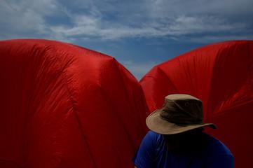 Andrew Beattie deflates his giant teddy bear kite at the beach on Bull Island on a sunny day near Dublin