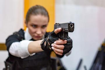 Powerful Woman Holding Gun. War Action Movie Style