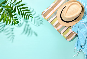 Sunny summer concept background with a strong shadow of palm leaf